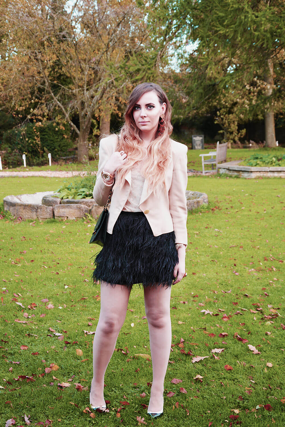 Edita in Micheal Kors Ostrich feather skirt, Chanel bag, Dior jacket, BCBG pumps and Ralph Lauren lace top 1