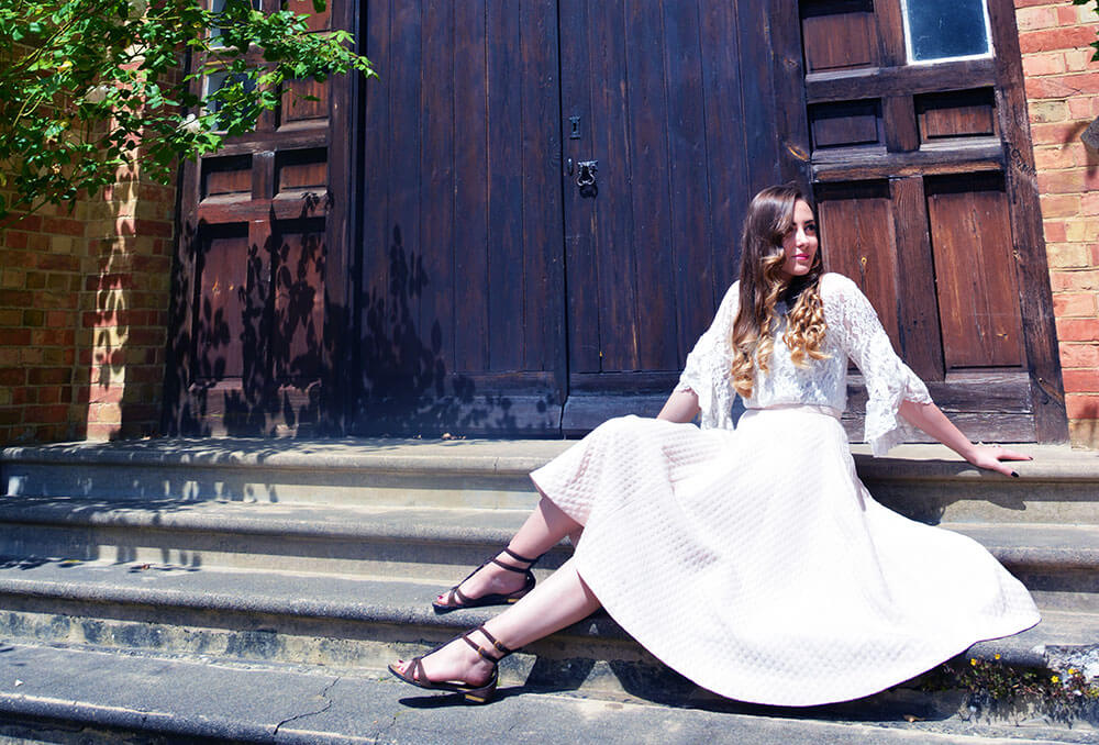 Edita in Tmart and HM skirt Kenneth Jay Lane earrings and Louis Vuitton sandals 4