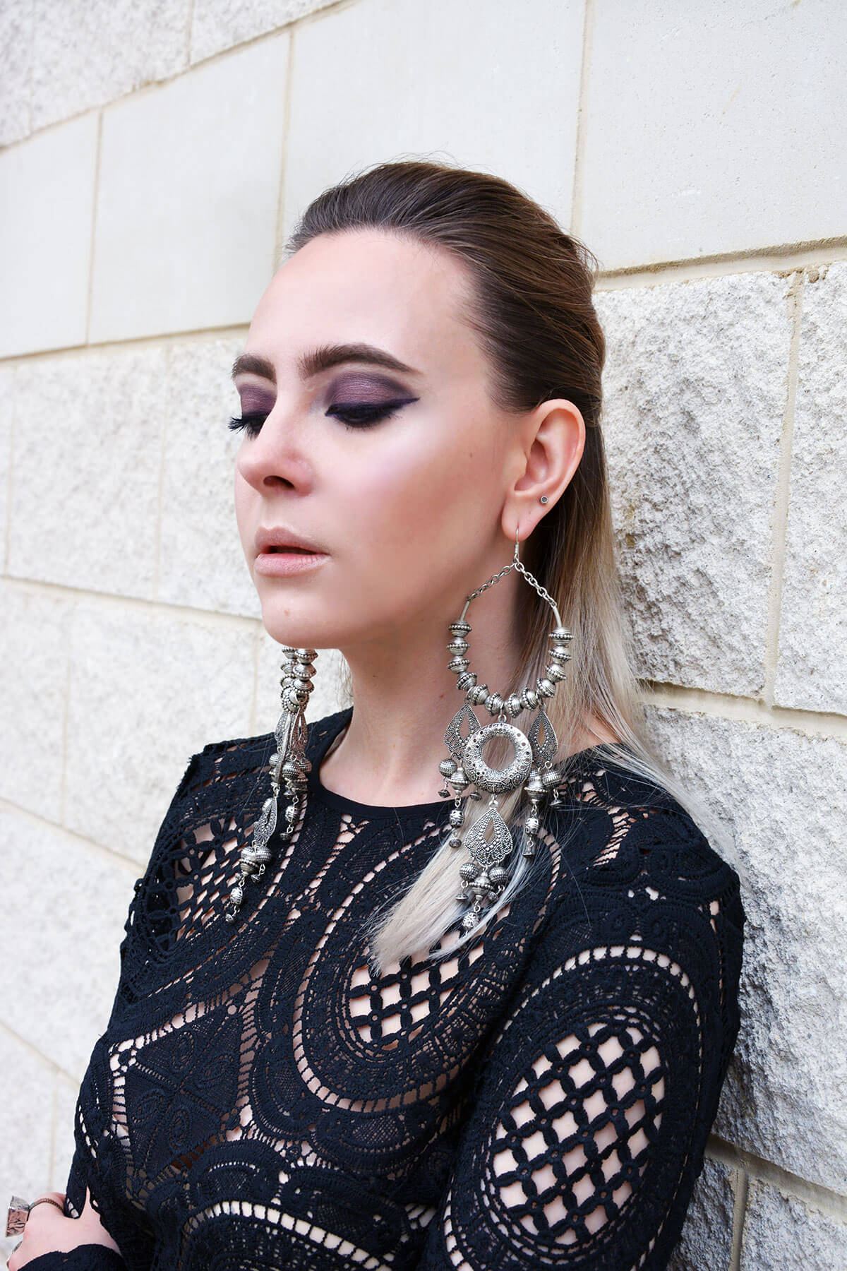 tough chic outfit with chandelier earrings